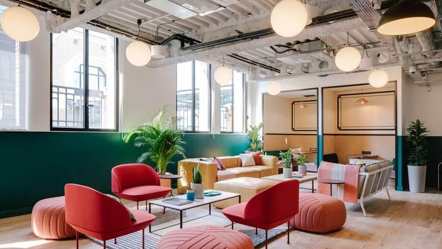 WeWork Common Area with Red Chairs and Booths