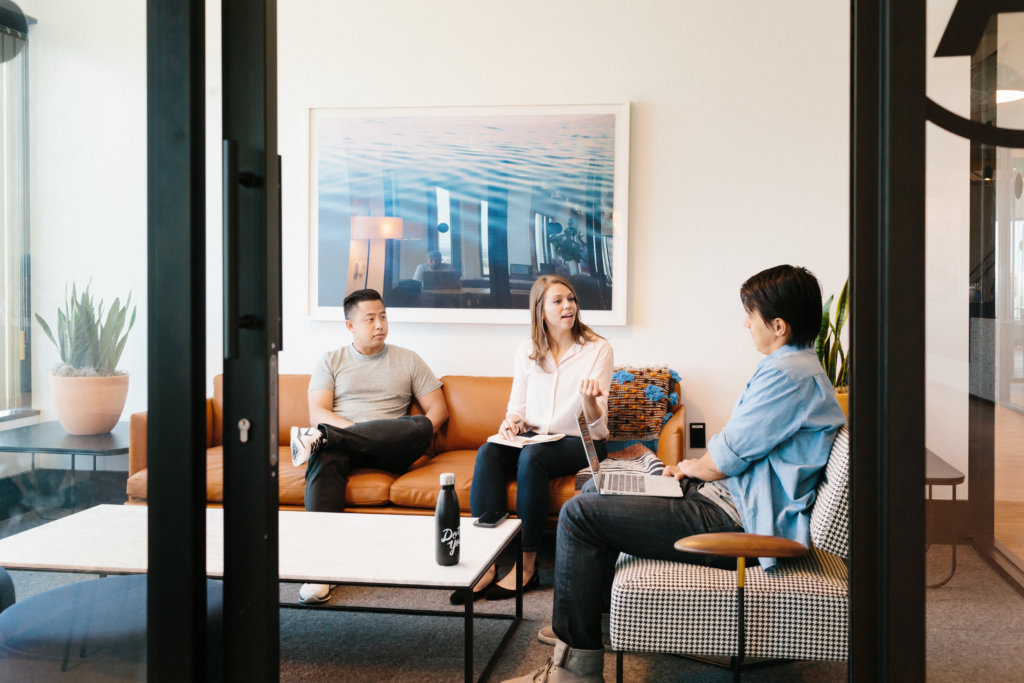 3 Colleagues Engaging in a Meeting Room at a WeWork Location